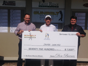 Mike Attara, winner Javier Sanchez, and Eagle Ridge Golf Head Pro Kevin Beirne at the check presentation.